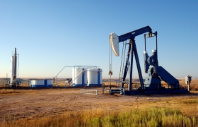 Oil well and storage tanks in the Texas Panhandle.